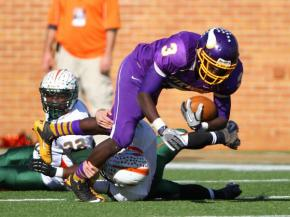 Quentin Robertson # 3 for Tarboro. East Lincoln takes title over Tarboro with 24 to 20 victory. NCHSAA 2 A Football Championship Game Winston-Salem, NC 12.1.12. Photo by CHRIS BAIRD