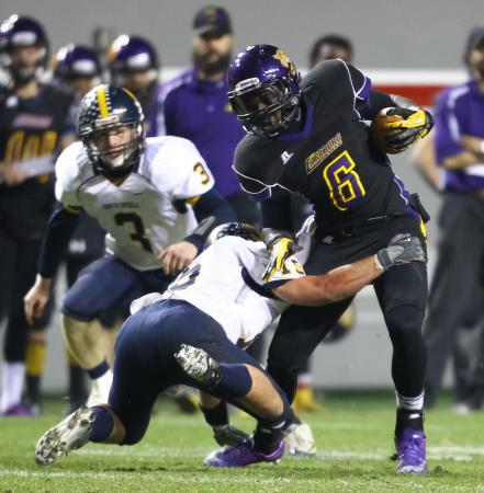 Carrboro's #6 Marlin Johnson runs the ball as South Iredell comes back to defeat Carrboro 30 to 27 in the 2AA NCHSAA Football State Championship Saturday December 1, 2012. (Photo by Jack Tarr)