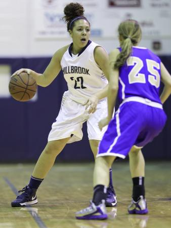 Millbrook's #22 Katelyn Mitchell dribbles the ball as Millbrook defeats Broughton 56 to 40 Friday night December 14, 2012. (Photo by Jack Tarr)