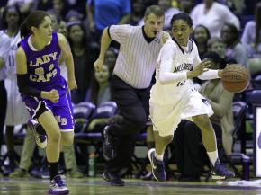 Millbrook's #15 Mykia Jones dribbles the ball as Millbrook defeats Broughton 56 to 40 Friday night December 14, 2012. (Photo by Jack Tarr)