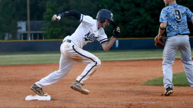 Brian Miller (5) sprints for home after an overthrow gives him an opportunity to advance. Millbrook shut out Panther Creek 5-0 to advance to the Regional Final. (Photo by: Jerome Carpenter)