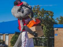 Photos: East Wake receives equipment from Carolina Mudcats