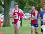 Iowa teen helps disabled opponent finish race
