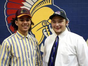 Garner's Vince Jefferies (left) signed with Shaw University while Anthony Galavotti (right) signed with Western Carolina University. (Photo Courtesy: GarnerTrojans.com)