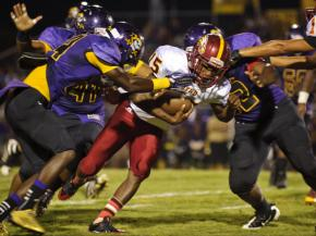 Douglas Byrd's Raheem Generette moves the ball up the field during their game at Jack Britt Friday night.