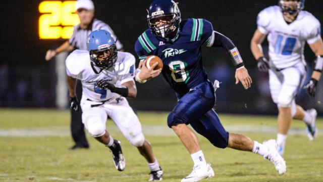 Braxton Berrios (8) finds some running room.  Leesville Road loses to Panther Creek at home with a score of 34 to 21.