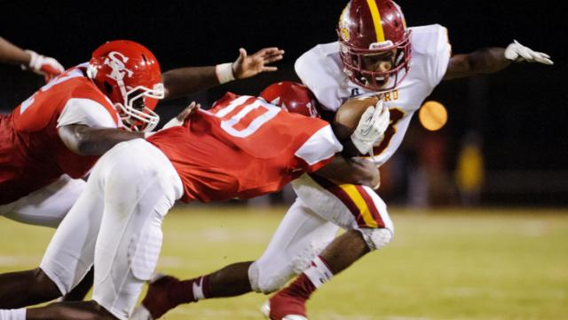 Douglas Byrd's Alonzo Hurtado is tackled by Seventy-First's Carlos Lawrence during their game Friday night.