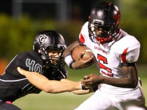 Southern Durham's #5 William Cameron runs the ball as Southern Durham defeats Cardinal Gibbons 45 to 28 Friday night October 11, 2013. (photo by Jack Tarr 2013)