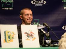 Leesville Road football player Braxton Berrios verbally committed to Miami during a press conference at his high school on Saturday.