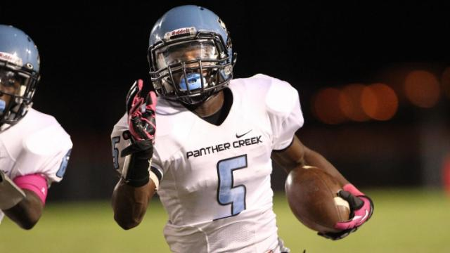 Dorrel L. McClain (5) finds some running room. Panther Creek travels to Fuquay-Varina for some Friday night football. After a 10-16 halftime lead for the Bangles, Panther Creek shut down Fuquay-Varina in the second half scoring 24 unanswered points for a 34 to 16 victory. Photo by CHRIS BAIRD