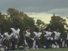 Hillside football players kneel during national anthem
