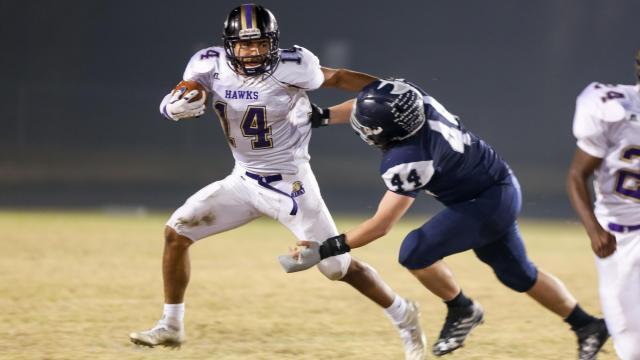 Broderick Taylor (14) of Holly Springs and Joe Kane (44) of Heritage. The Heritage Huskies defeat visiting Holly Springs Golden Hawks, 14-17 in the first round of the NCHSAA football playoffs. Friday, Nov 18,  2016.  (Photo By: Karl Fisher/HighSchoolOT.com)