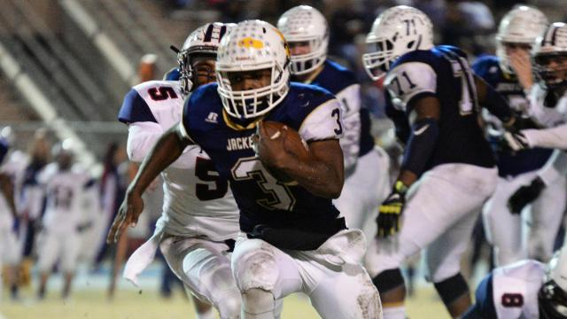 Jahmir Smith (3) of Lee County. Lee County High School crushes Terry Sanford High School 35 to 3 to adavance to the 3rd round of the NCHSAA Playoffs on Friday, November 25, 2016.(Photo By: Beth Jewell/HighschoolOT)