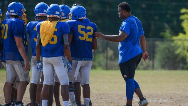 Former Garner football player Greg Milhouse helps out the Garner coaching staff. Garner's football team practiced on the first day of full contact on Saturday, Aug. 5, 2017. (Photo By: Nick Stevens/HighSchoolOT.com)