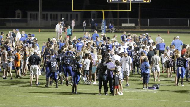 Field full of fans and players as the celebrate the victory at Clayton, NC on Friday, August 18, 2017. (Photo By: Carl Copeland/HighSchoolOT.com)
