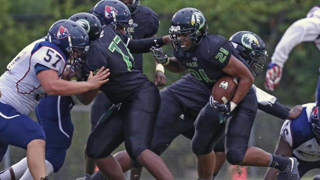 Enloe's Hamilton Moore (21) tries to get outside for extra yardage. The Enloe Eagles defeated the Apex Friendship Patriots 14-7 played at Enloe High School on Thursday, August 31, 2017.  Photo by Dean Strickland, OD.