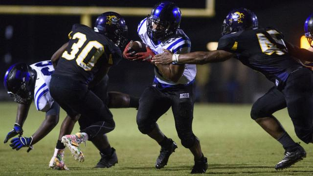 Scotland's Tymere Graham tries to break through Jack Britt's defensive covereage during their game at Jack Britt September 22, 2017. [Melissa Sue Gerrits/The Fayetteville Observer]