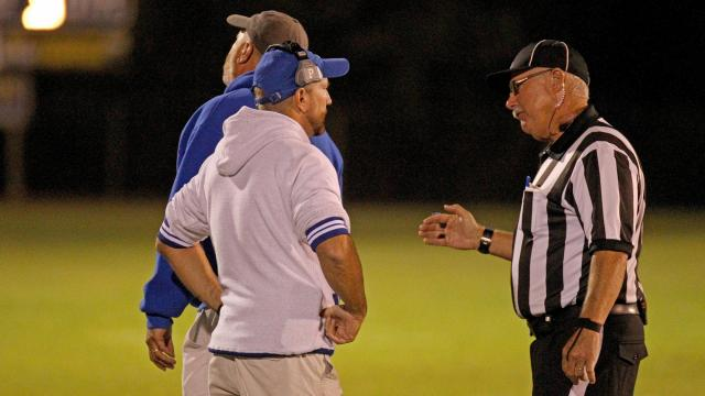 a4dd2bc5d Referee talks over penalty call with Hunt s coach Keith Byron. Rocky Mount  Gryphons visited Hunt