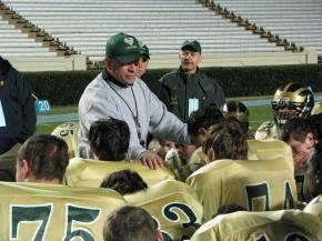 South Johnston's head coach Joe Salas consoles his team after they are defeated 42-28 by South Point for the 3-AA State Title.  Dec. 12, 2009 (Photo by Scott Lunn)