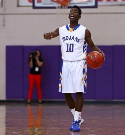 Garner's #10 Julius Barnes brings the ball up the court at the HighSchoolOT.com  Holiday Invitational Tournament December 26, 2012. (Photo by Jack Tarr)