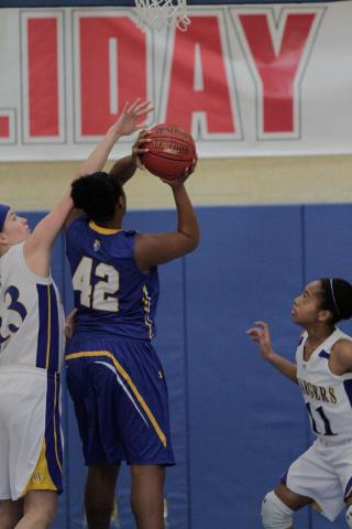 East Wake's Shayla Tanner (42) takes a layup at the HighSchoolOT.com Holiday Invitational at Cary Academy Friday morning.  The Warriors defeated the Cary Academy Chargers 69-61 and earned 7th place in the tournament (photo by Wes Hight).
