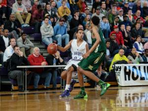 Jerome Robinson looks for team mates.  Kinston High Schools beats home school Broughton 49 to 46 on the first day of the HSOT holiday invitational tournament.  (Photo by: Suzie Wolf/WRAL contributor)