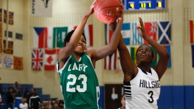Azura Stevens (23) and Tykyrah Williams (3) fight for a rebound. Cary defeated Hillside 61-58 on the second day of the HighSchoolOT.com Holiday Invitational in Raleigh, NC on December 27, 2013. Photo by: Jerome Carpenter