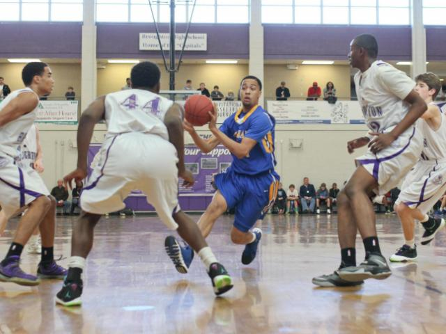 HighSchoolOT Holiday Invitational at Broughton High School, Raleigh N.C. held on December 27, 2013. The afternoon games included Garner vs Broughton. Broughton defeats the Garner Trojans with a final score of 79 – 69 (Lexi Baird / WRAL Contributor).