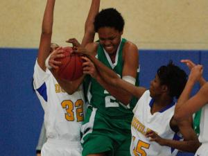 Cary's Azura Stevens (23) pulls down the rebound during play at the final day of the HighSchoolOT.com Holiday Invitational held at Cary Academy in Cary, N.C. between the Cary Imps and the Dudley Panthers on December 28, 2013. Photo by Wes Hight.