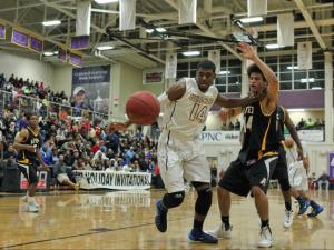 Elijah Staley (14) shoots the ball for Wheeler. HighSchoolOT Holiday Invitational at Broughton High School, Raleigh N.C. held on December 28, 2013. The evening games included Apex against Wheeler High School. Wheeler wins by 30 with a final score of 75 – 45. (Lexi Baird/ WRAL Contributor)