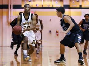 Apex's #10 T.J. Wells passes the ball during the game Tuesday January 29, 2013. (Photo by Jack Tarr)