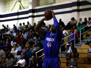 Tyrone Outlaw Jr. (44) raises up for a three pointer during the Person vs. Hillside game on February 1, 2013 in Durham North Carolina