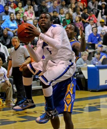 Clayton's #5 Anthony Gaskins drives the lane during the game Wednesday February 6, 2013  (Photo by Jack Tarr)