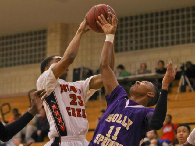 Middle Creek's #23 Fred Iruafemi grabs a rebound during the game Tuesday February 12, 2013. (Photo by Jack Tarr)