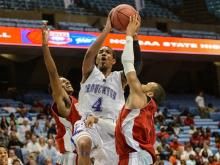 Devonte Graham pushes through to the basket.  Olympic beats Broughton with a score of 56 to 53.  Photo By: Suzie Wolf