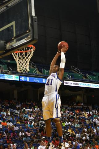 Broughton guard Devonte Graham dunks the ball after passing it off the backboard to himself.