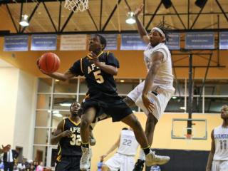 TJ Wells (5) puts the ball up for Apex Apex re-visits Panther Creek High School to finish their game that was post-poned due to a broken backboard. Apex High comes back and ends the game with a final score of 61 - 74, with Apex taking home the win. (Lexi Baird / WRAL Contributor)