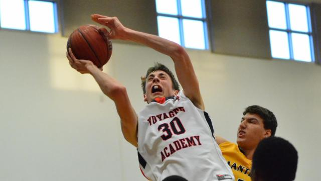 Jay Huff (30) of Voyager Academy. Manteo visits Voyager Academy in the second round of the NCHSAA 1-A Boys Basketball Playoffs. Voyager Academy runs away with it and defeated Manteo 68-31 on Monday, March 2, 2015. (Photo By: Beth Jewell/ HighSchoolOT.com)