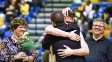 IMAGE: Garner basketball player surprised by brother returning from deployment