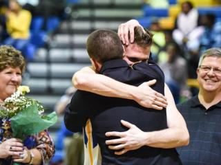 US Army Specialist Max Kuhns flies in to surprise his brother on Senior Night. Roseville High School travels to Garner High School.  Garner has a big win on Senior Night 71 to 35.(photo by:  Suzie Wolf)