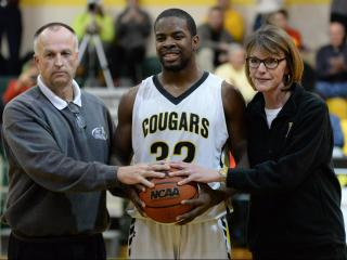 Ian Boyd (32) of Apex High School receiving the game ball after getting his 2,000 point. Apex High School's Ian Boyd (32) get's his 2,000 career high with the win over Middle Creek 76-48.  Apex finishes second in the SWAC on Thursday, February 11, 2016. (Photo By: Beth Jewell/HighSchoolOT.com)