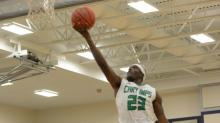 IMAGE: Cary outlasts Middle Creek in SWAC semi-final, 80-69