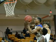 Garner was in a close game at halftime, but the Trojans pulled away from Knightdale in the second half to claim the Greater Neuse River Conference Tournament title on Thursday night.