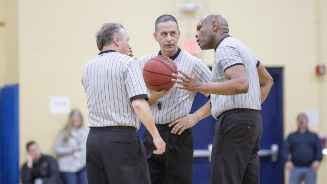 8ae2985c0 Referees discussing the call. Northwood Temple Academy Eagles and  Greenfield School Knights meet for the