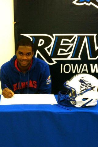 Former Panther Creek player Isaiah Johnson signs with Kansas.