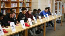 IMAGE: Nine Middle Creek senior football student-athletes sign NLIs