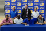 Three Garner athletes sign with colleges