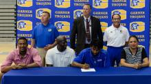 IMAGES: Three Garner athletes sign with colleges