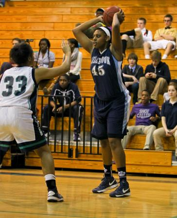 Millbrook's #45 Ryan Flowers passes from the corner as Leesville Road hosted Millbrook Friday night January 11, 2013. (Photo by Jack Tarr)