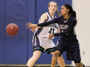 Millbrook's #15 Mykia Jones passes the ball as Leesville Road hosted Millbrook Friday night January 11, 2013. (Photo by Jack Tarr)